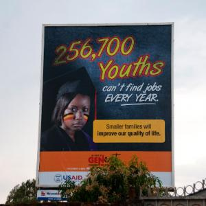 Youth bulge: A public billboard in Uganda urges young people to have smaller families.