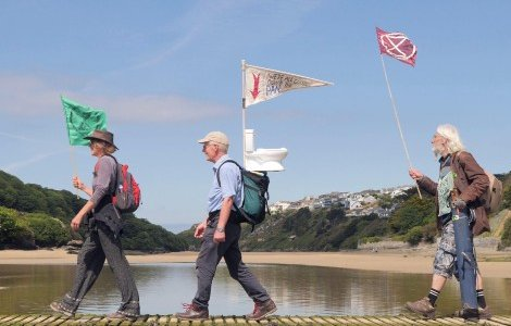 A climate action group are pictured in Newquay, Cornwall, starting a four-day pilgrimage on foot to Carbis Bay to protest climate inaction at theG7 conference.Credit: Robert Taylor/Alamy Live News