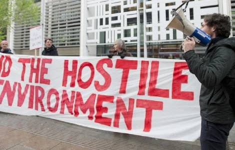 Protestors from Global Justice Now demonstrate outside the Home Office in London demanding an end to the Hostile Environment policy, ahead of parliamentary debate on the Windrush scandal. April, 2018. David Mirzoeff/Global Justice Now