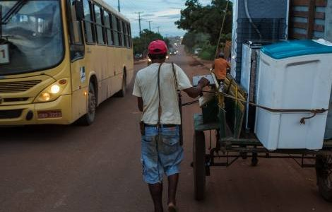 Searching for sustenance: In Para State, a man moves his furniture in a cart after struggling to make rent following food price inflation beginning in 2013. Credit Lalo de Almeida/Folhapress/Panos