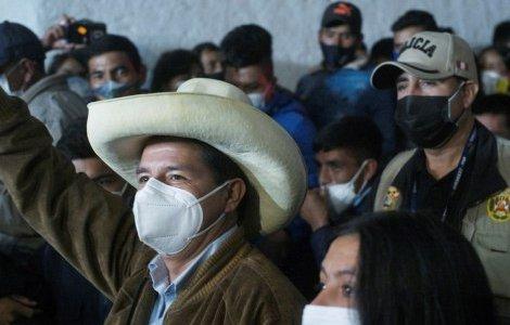 Peru's presidential candidate Pedro Castillo gestures to supporters, in Tacabamba, Peru June 6, 2021. REUTERS/Alessandro Cinque