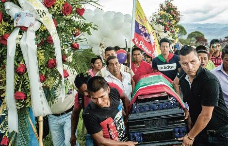 The road to peace in Colombia: the funeral in April 2017 of indigenous leader Gerson Acosta, among the hundreds killed since the peace deal of 2016.