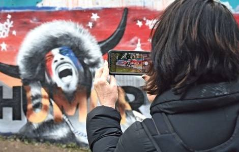 A mural featuring a pro-Trump protester, self-styled QAnon 'shaman' Jacob Chansley, appeared in Tunbridge Wells, UK, a few days after the storming of the US Congress in Washington on 6 January. KARWAI TANG/WIREIMAGE/GETTY
