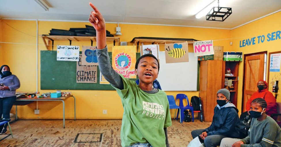 Internationalize it! A girl takes part in a global day of action on climate change in Khayelitsha township near Cape Town, South Africa in September 2020. SUMAYA HISHAM/REUTERS
