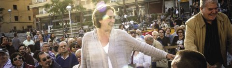 Ada Colau arrives at a municipal elections rally.