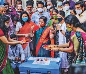 : Government officials pray over a storage box containing Covid-19 vaccines before they leave for various vaccination centres in Mumbai, India, in January this year. India is one of the countries that is calling for patents on Covid-19 vaccines to be waived during the pandemic. DHIRAJ SINGH/BLOOMBERG/GETTY