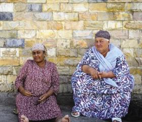 Two women sheltering from the heat. A look at Uzbekistan today