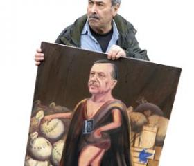 Artist Kaya Mar with his satirical portrait Erdoğan, the Turkish Sun King – after France's absolute monarch Louis XVI.