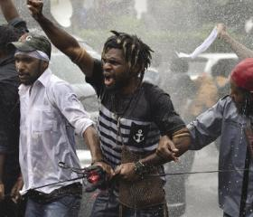 University students from the Free Papua Organization and the Papua Student Alliance resist police using water cannons during a protest in Jakarta, 1 December 2016. University students from the Free Papua Organization and the Papua Student Alliance resist police using water cannons during a protest in Jakarta, 1 December 2016. West Papua petition