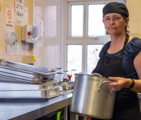 Penny Walters in the kitchen at Byker Community Centre where she volunteers as a chef twice a week. Credit: Tessa Bunney