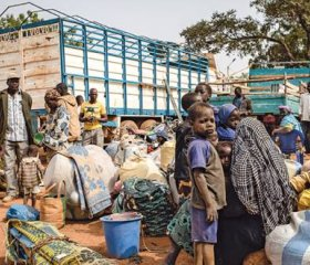 Newly displaced people waiting by the side of the road after fleeing attacks in Barsalogho, in northcentral Burkina Faso. TOM PEYRE-COSTA/NORWEGIAN REFUGEE COUNCIL