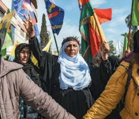 Women in Qamishlo, the de-facto capital of Rojava, protest against a Turkish-Russian deal that threatens them and the gains of their revolution. Delil Souleiman/AFP/Getty