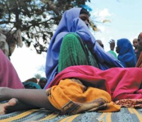 Forced from home by US airstrikes in the Lower Shabelle region, this girl tries to rest at a camp for internally displaced persons near Mogadishu, Somalia, March 2020.