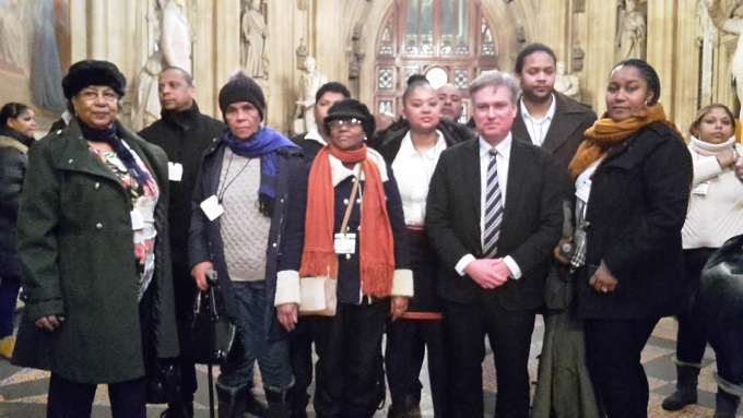 Henry Smith, MP for Crawley, with Chagossians.