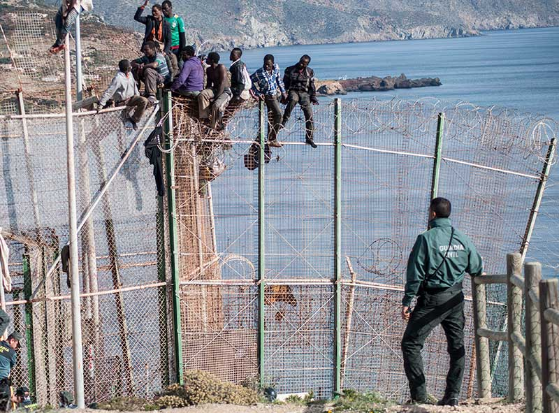 As Spain becomes the busiest staging post on the migrant Mediterranean route, Julian Hattem speaks to the African migrants in its North African enclaves Melilla and Ceuta