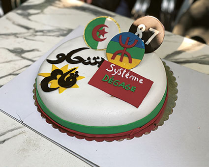 The cake proclaims that the regime (système) has to move (dégage), a popular slogan of the protests.Credit: RIAD KACED