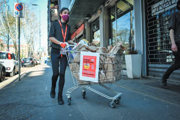Solidarity in Milan: a volunteer with a mutual aid network distributes food and other necessities. Lapresse/Sipa Usa/PA Images