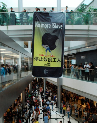 'No more iSlave': activists unfurl a banner at an Apple retail store opening in Hong Kong, 2011. Foxxcon is Apple's biggest supplier. China industrial robots
