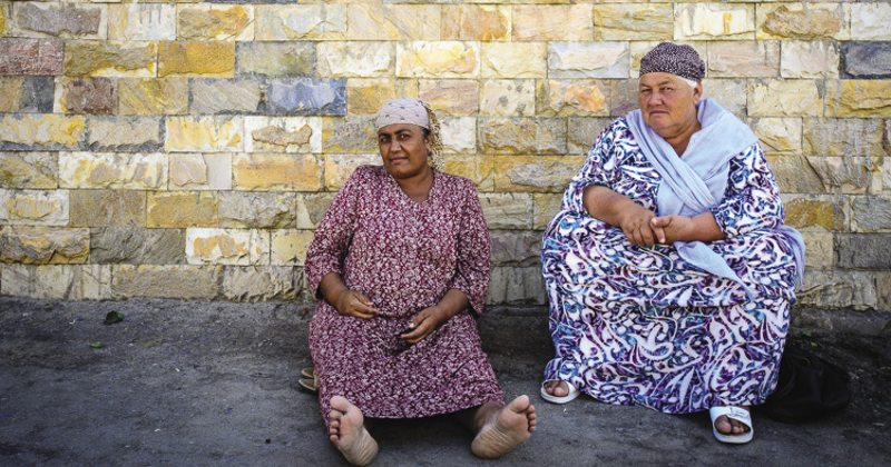 Two women sheltering from the heat. Uzbekistan today