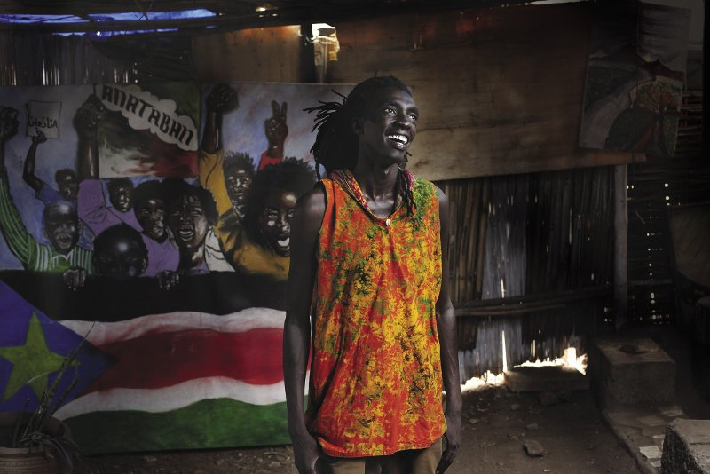 SoUTh SUDAN  For four years, South Sudan has been divided by conflict and unrest. But for 'artivists' like Manasseh Mathiang (pictured) – who played an active role in mobilizing fellow South Sudanese to vote in the 2011 referendum – art is the perfect platform for teaching tolerance in times of division and hate. The 33-year-old is a founding member  of 'Ana Taban' (Arabic for 'I'm tired') –  a group of musicians, fashion designers and poets who use regular open-air performances to demand peace and educate fellow citizens about nonviolent conflict resolution.  Photo: Andreea Campeanu/Reuters