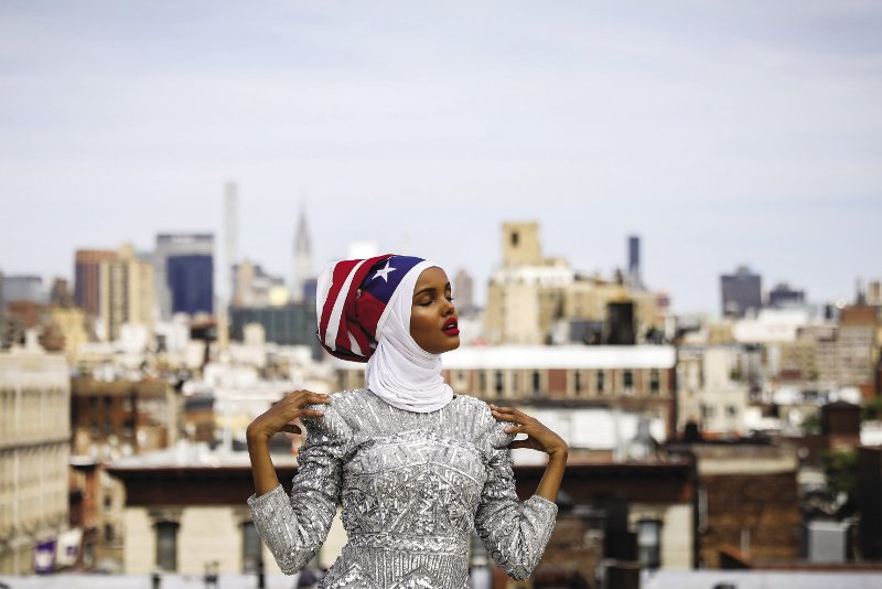 UNITED STATES  Fashion model and former refugee Halima Aden, who is breaking boundaries as the first hijab-wearing model gracing magazine covers, poses during a shoot at a studio in New york City. Within weeks of his inauguration, President Trump signed an executive order to ban visas and entry for anyone, including US nationals, born in Muslim-majority countries such as Iran, Iraq and Somalia (Aden's birthplace). Trump's Islamophobic stance resurfaced in late November, when he retweeted several anti-Muslim videos posted by a British farRight group – sparking international outrage. Photo: Brendan McDermid/Reuters