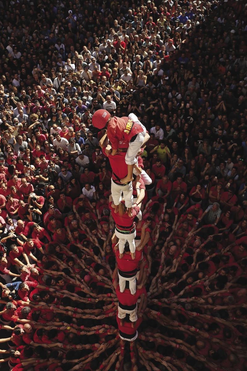 SPAIN  steady on: a helmeted child climbs a precarious human tower where he will help the final participant – an even younger child – to climb to the very top.  This is all part of the saint Ursula festival, held on 22 october, in Valls, Catalonia. There are challenges for the two teams, as towers collapse, and celebrations when the human castells are completed. since the death of spanish dictator Franciso Franco in 1975 Catalan culture has experienced a resurgence, as have calls for independence from spain. In september voters taking part in a controversial independence referendum  were violently attacked by spanish police. Photo: Sean Gallup/Getty