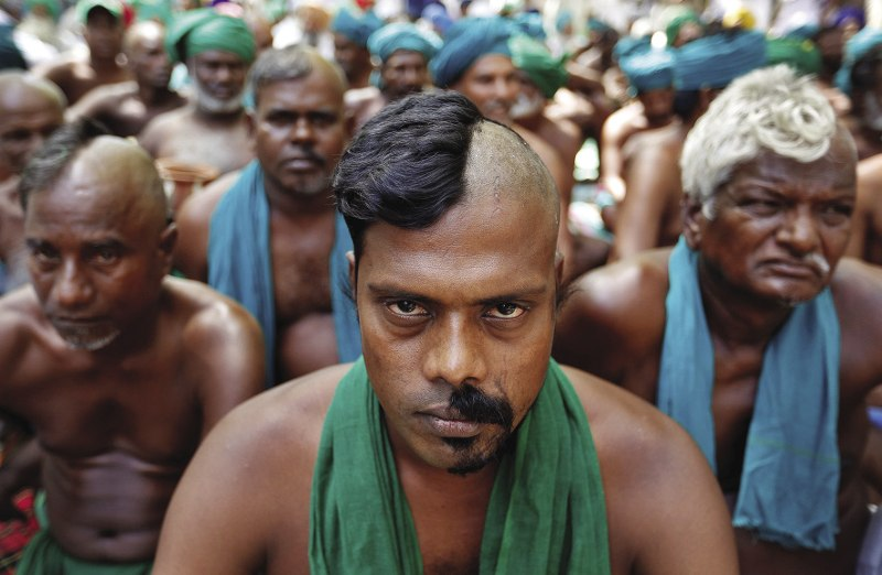 INDIA  Farmers from the southern state of Tamil Nadu pose half-shaved during a protest to demand a  better drought-relief package from the federal government in New Delhi, India. Having recently experienced one of the worst droughts in over 140 years, 150 Tamil Nadu farmers took to the streets in March armed with props, skulls, mice and snakes – performing one desperate act after another for an entire month. In midApril, Prime Minister Narendra Modi, and his Bharatiya Janata Party, announced the provision of debt-relief to 21.5 million farmers, despite criticism from some economists. Photo: Cathal McNaughton/Reuters