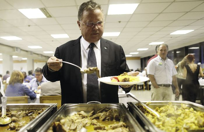 Helping himself to a beef dinner in Brasilia, soy billionaire and now agriculture minister, Blairo Maggi.