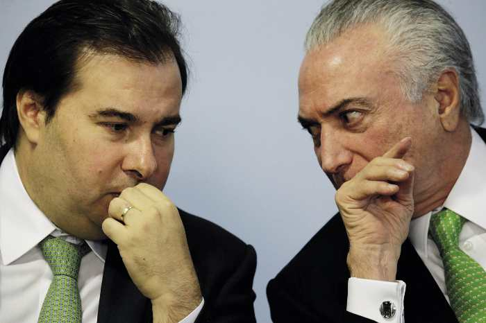 'Shall we just sell off the Amazon?' Michel Temer (right) with his vice-president Rodrigo Maia at an enviroment summit. Note the matching green ties.