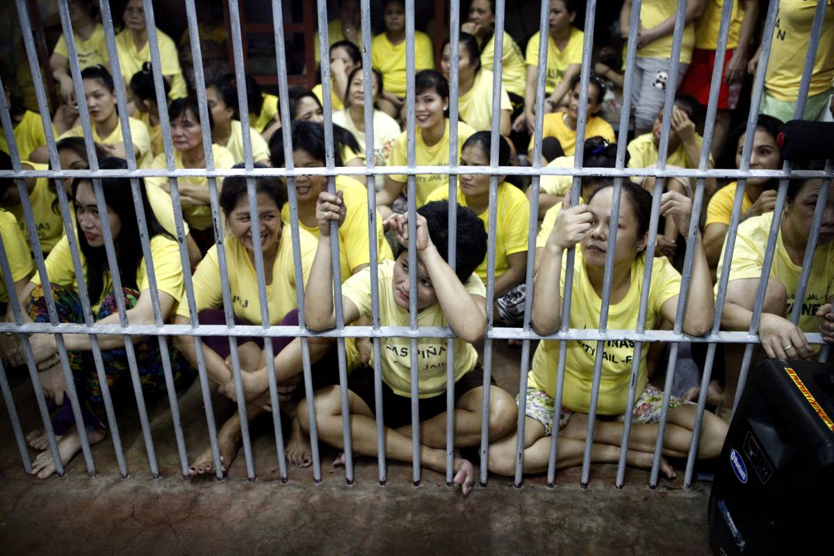 Philippine prisons: since there is no room for a community area in the female dorm of Las Piñas Jail, inmates have their daily activities in their cell.