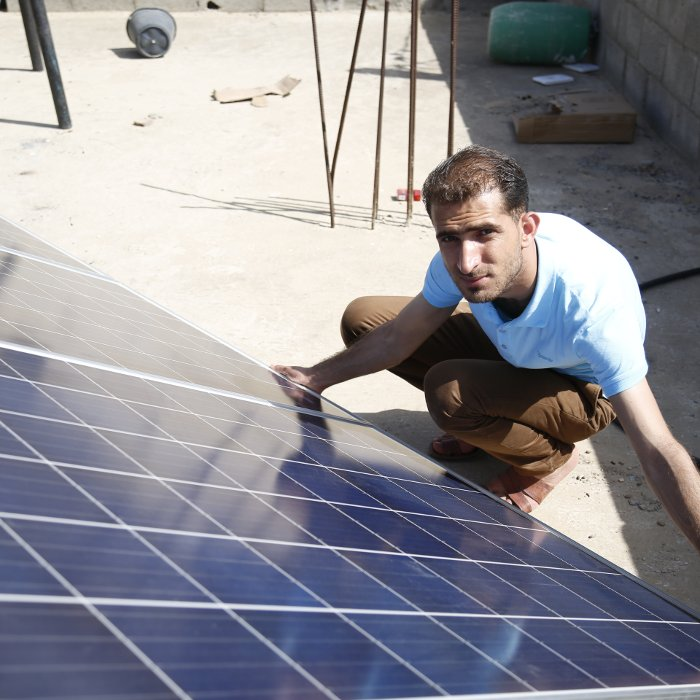 The electricity crisis in Gaza: blogger and photojournalist Walid Rouk installs solar panels.