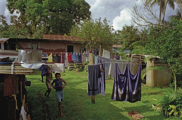 Fiji profile: Temporary housing on the outskirts of Suva for Lau islanders who have come to the main island of Viti Levu seeking work.