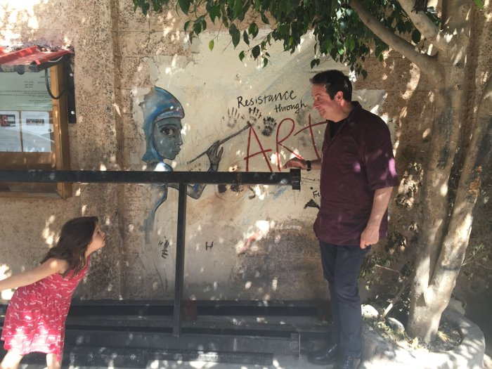 Comedian Mark Thomas is stared down by a young Palestinian girl.