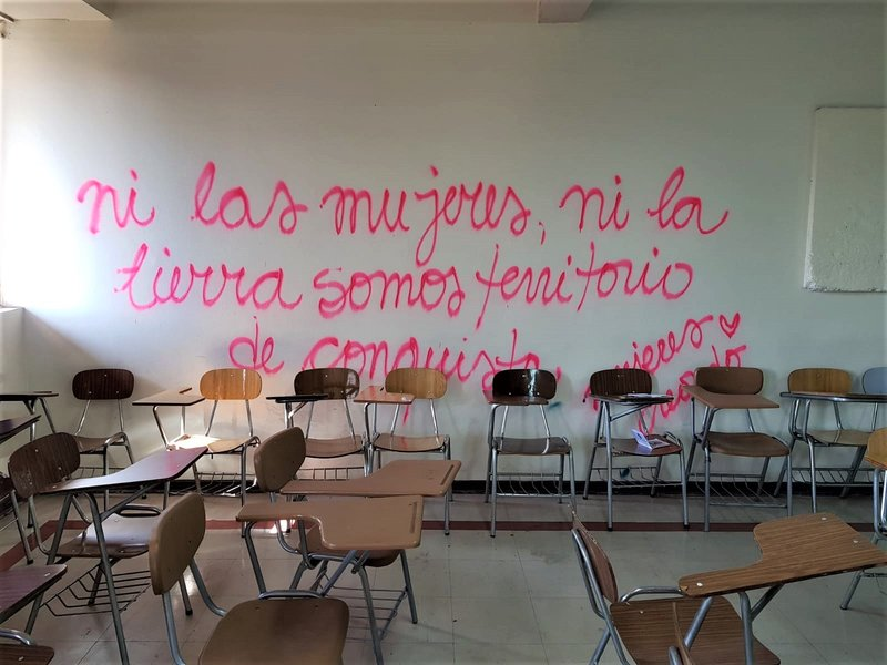 Feminist students have occupied universities across Chile: In an occupied classroom, graffiti reads 'Neither women nor the land are territories of conquest'.