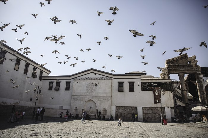 Portraits of three Syrian cities: Pigeons outside Damascus' Umayyad Mosque take flight at the sound of nearby bombing in besieged suburbs Jobar and Eastern Ghouta.