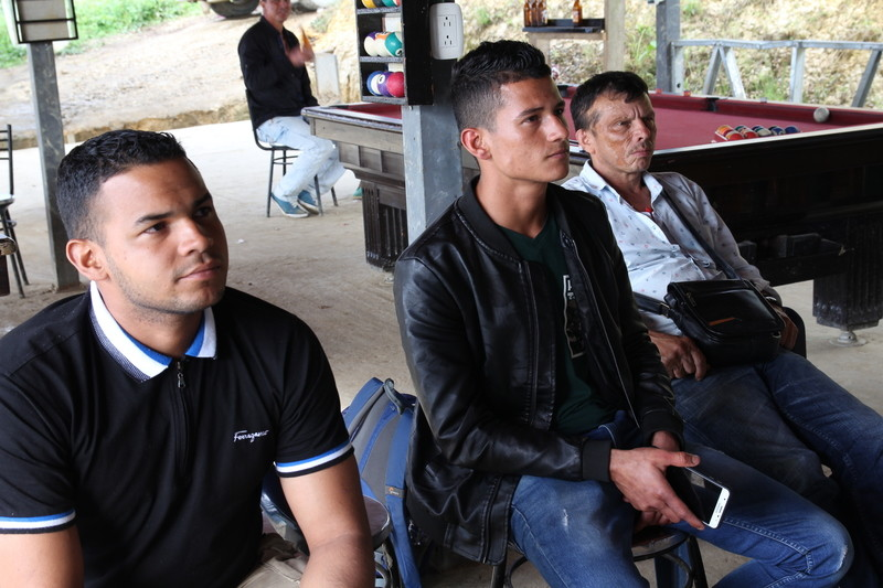 FARC guerillas are worried for their future after the right-wing Duque was elected president. Photo: Three former guerrillas watch the election results from La Tienda, the social space in the Icononzo reintegration zone.