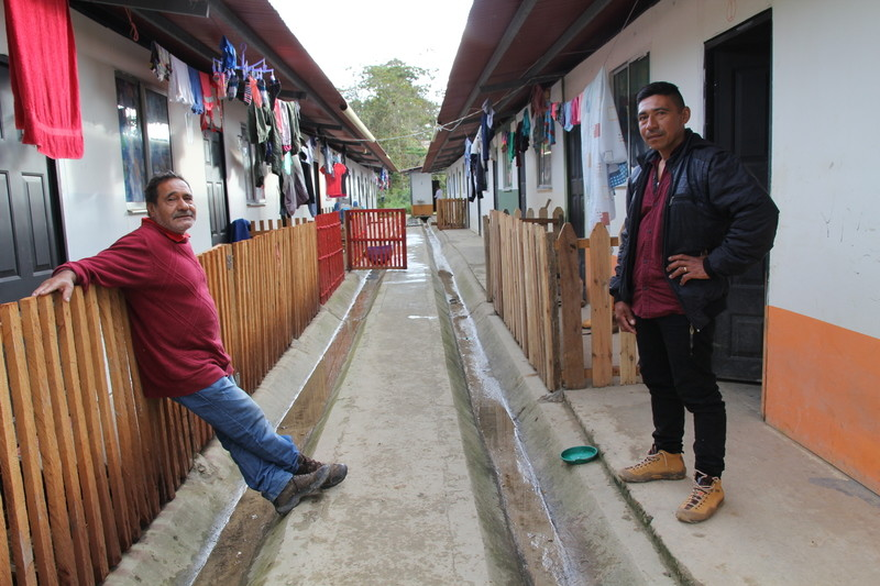 FARC guerillas are worried for their future after the right-wing Duque was elected president. Photo: Two former guerillas outside their houses.
