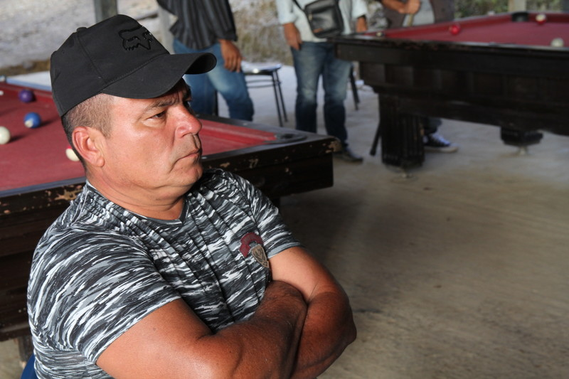 FARC guerillas are worried for their future after the right-wing Duque was elected president. Photo: A former guerrilla stares at the television in silence, after it was announced that Ivan Duque will be the next president.