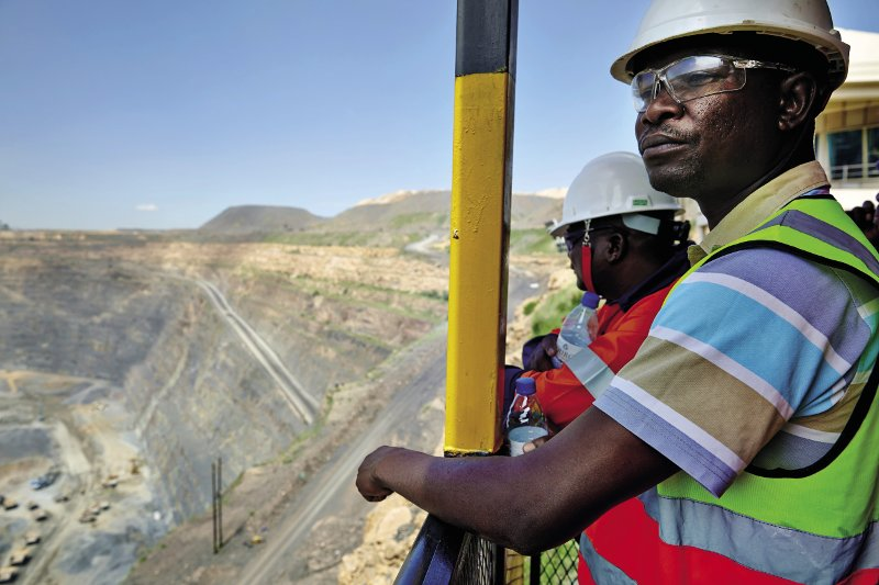 Looking out over the main pit of the Jwaneng mine in the Kalahari – the richest diamond mine in the world.